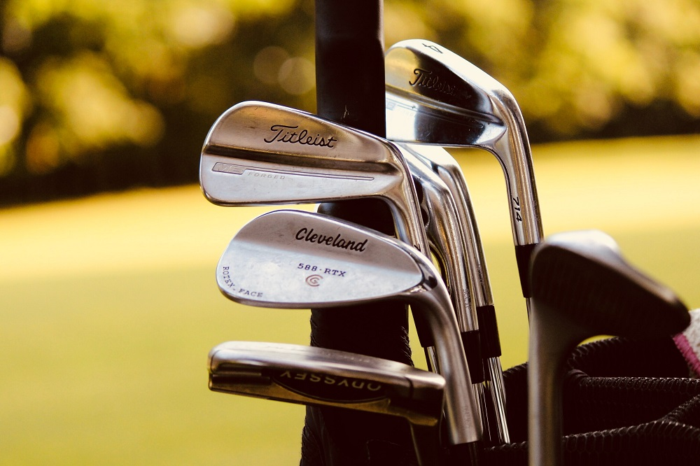 a set of used golf irons in a bag